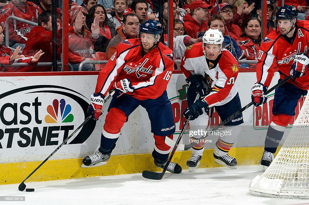 <a gi-track='captionPersonalityLinkClicked' href=/galleries/search?phrase=Eric+Fehr&family=editorial&specificpeople=566939 ng-click='$event.stopPropagation()'>Eric Fehr</a> #16 of the Washington Capitals handles the puck against <a gi-track='captionPersonalityLinkClicked' href=/galleries/search?phrase=Brian+Campbell+-+Ice+Hockey+Player&family=editorial&specificpeople=209384 ng-click='$event.stopPropagation()'>Brian Campbell</a> #51 of the Florida Panthers at the Verizon Center on March 7, 2013 in Washington, DC. Washington won the game 7-1.