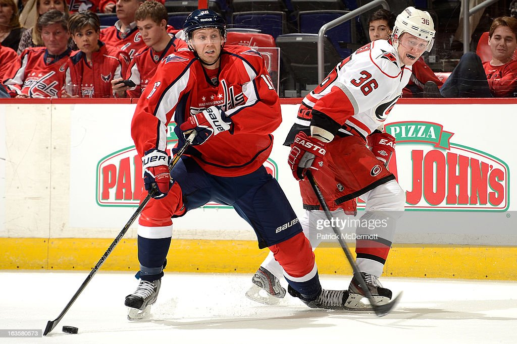 <a gi-track='captionPersonalityLinkClicked' href=/galleries/search?phrase=Eric+Fehr&family=editorial&specificpeople=566939 ng-click='$event.stopPropagation()'>Eric Fehr</a> #16 of the Washington Capitals handles the puck against <a gi-track='captionPersonalityLinkClicked' href=/galleries/search?phrase=Jussi+Jokinen&family=editorial&specificpeople=570599 ng-click='$event.stopPropagation()'>Jussi Jokinen</a> #36 of the Carolina Hurricanes during an NHL game at Verizon Center on March 12, 2013 in Washington, DC.