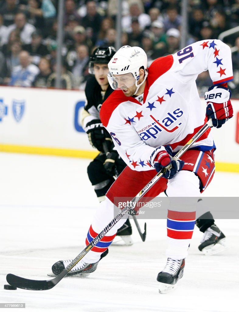 <a gi-track='captionPersonalityLinkClicked' href=/galleries/search?phrase=Eric+Fehr&family=editorial&specificpeople=566939 ng-click='$event.stopPropagation()'>Eric Fehr</a> #16 of the Washington Capitals handles the puck against the Pittsburgh Penguins during the game at Consol Energy Center on March 11, 2014 in Pittsburgh, Pennsylvania.