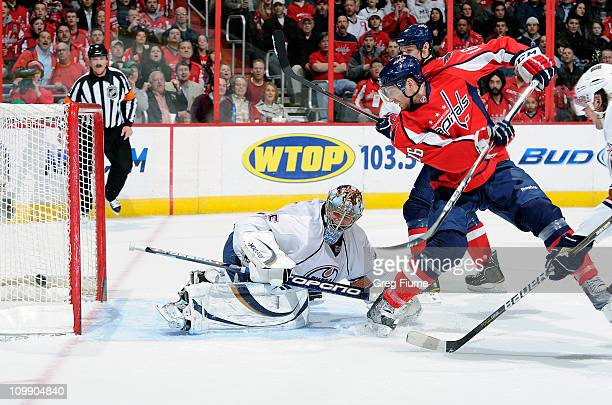 Eric Fehr of the Washington Capitals scores in the second period against Nikolai Khabibulin of the Edmonton Oilers at the Verizon Center on March 9...