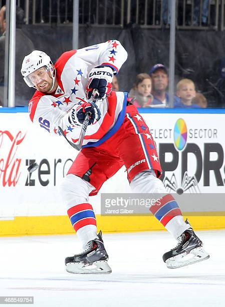 Eric Fehr of the Washington Capitals shoots the puck into the zone against the New York Rangers at Madison Square Garden on March 29 2015 in New York...