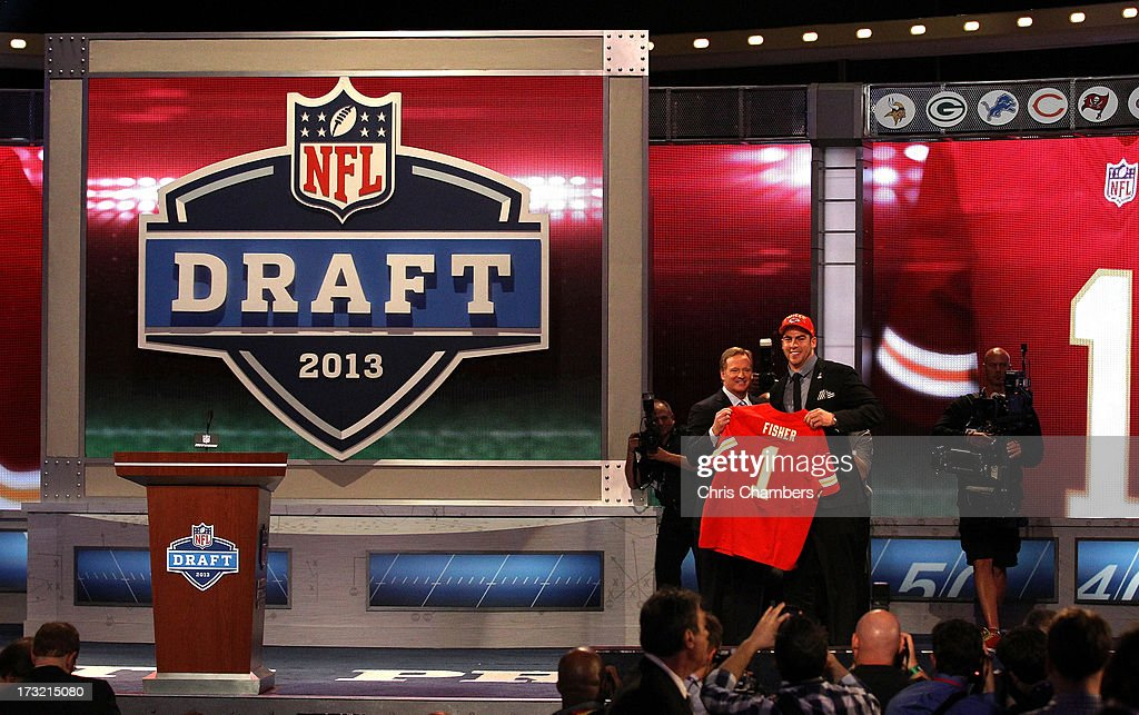 Eric Fisher (R) of Central Michigan Chippewas stands on stage with NFL Commissioner <a gi-track='captionPersonalityLinkClicked' href=/galleries/search?phrase=Roger+Goodell&family=editorial&specificpeople=744758 ng-click='$event.stopPropagation()'>Roger Goodell</a> after Fisher was picked #1 overall by the Kansas City Chiefs in the first round of the 2013 NFL Draft at Radio City Music Hall on April 25, 2013 in New York City.
