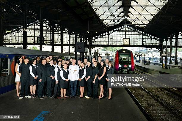Eric Frachon poses with his Le Lazare restaurant team on the platform of the SaintLazare train station on August 28 2013 in ParisFrance