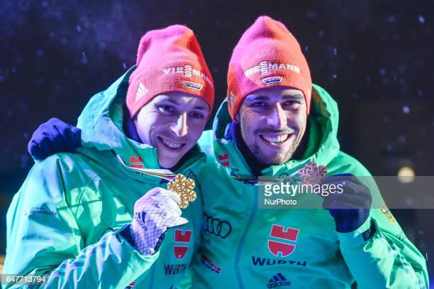 Eric Frenzel and Johannes Rydzek from Germany during the Awards Ceremony as they take Gold in Team Sprint LH / 2 x 77 km in Nordic Combined at FIS...