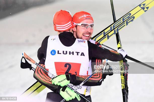 Eric Frenzel and Johannes Rydzek of Germany celebrate victory after the nordic combined team sprint 2x 75 km competition at the FIS Nordic Ski World...