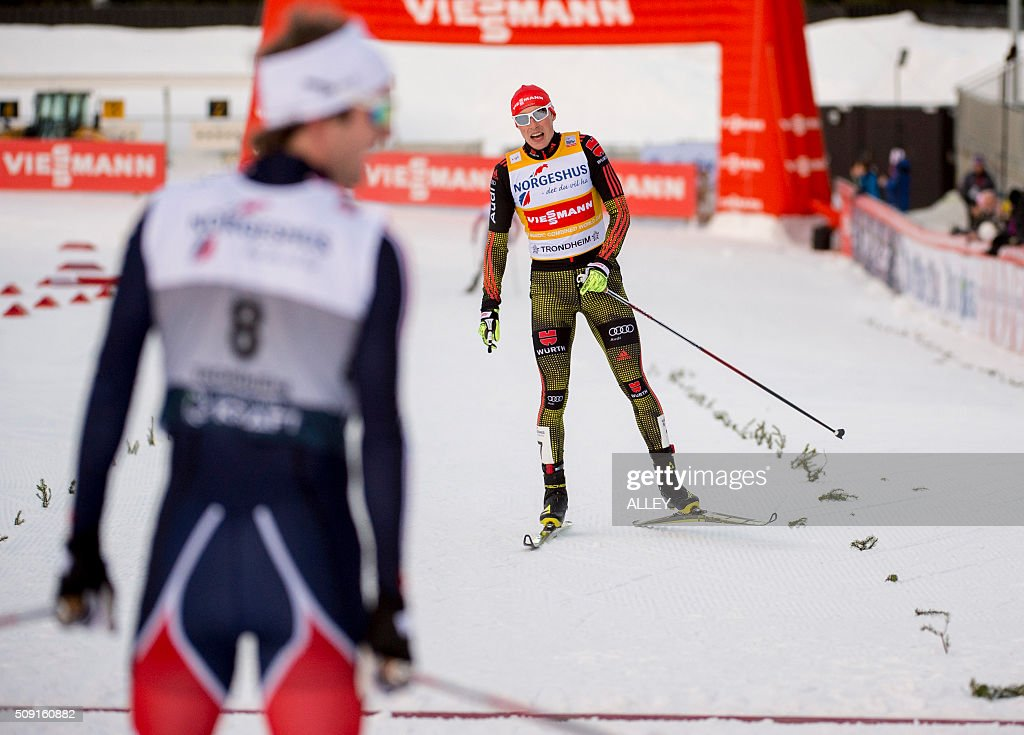 Eric Frenzel (R) from Germany takes second place behind winner Joergen Graabak (L) during the FIS World Cup Nordic Combined competition in Trondheim, on February 9, 2016. / AFP / NTB SCANPIX / Alley, Ned / Norway OUT