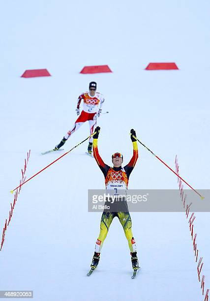 Eric Frenzel of Germany celebrates as he wins the gold medal ahead of Akito Watabe of Japan during the Nordic Combined Individual Gundersen Normal...