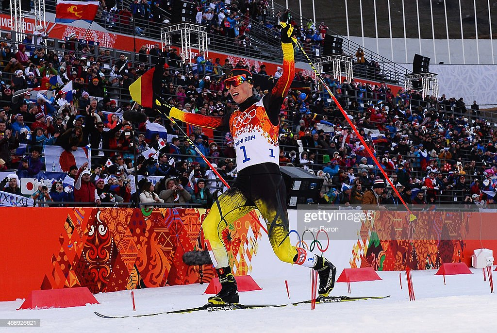 Eric Frenzel of Germany celebrates as he wins the gold medal during the Nordic Combined Individual Gundersen Normal Hill and 10km Cross Country on day 5 of the Sochi 2014 Winter Olympics at the RusSki Gorki Nordic Combined Skiing Stadium on February 12, 2014 in Sochi, Russia.
