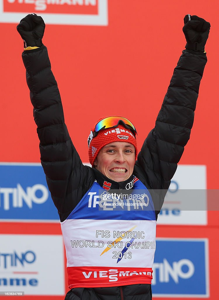 Eric Frenzel of Germany celebrates victory in the Men's Nordic Combined on the podium following the Individual Gundersen 10Km at the FIS Nordic World Ski Championships on February 28, 2013 in Val di Fiemme, Italy.