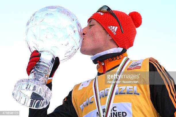 Eric Frenzel of Germany celebrates with the FIS Nordic Combined World Cup Trophy winning the FIS Nordic Combined World Cup 2013/2014 at...