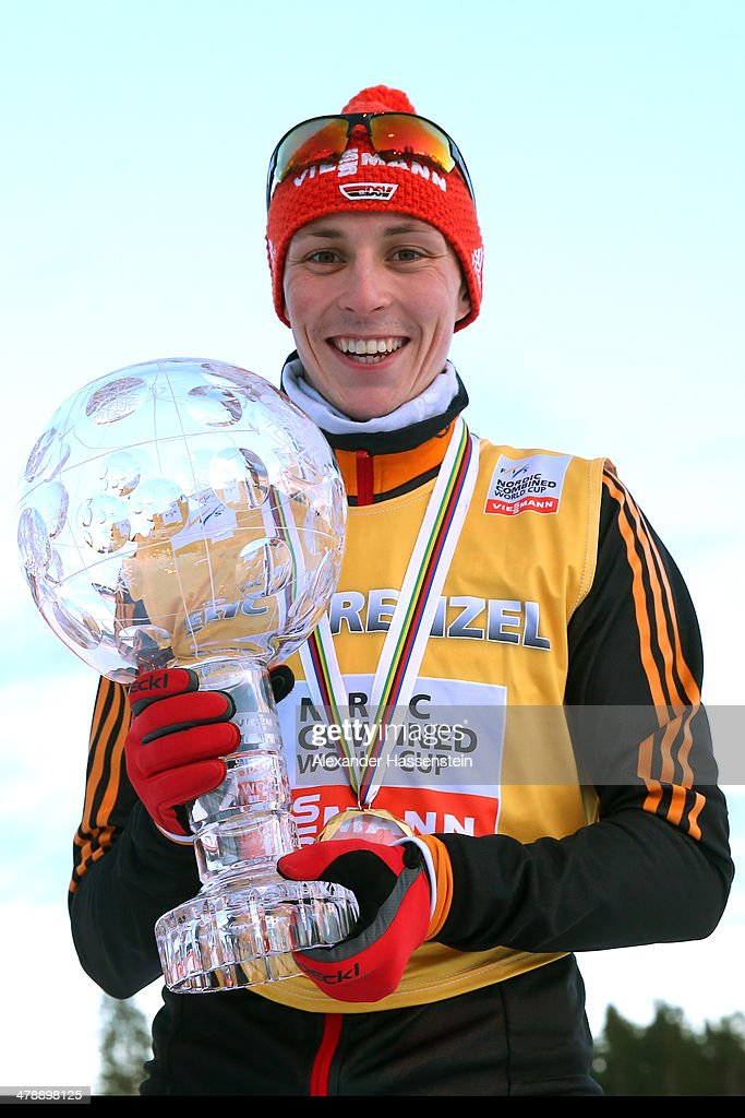 Eric Frenzel of Germany celebrates with the FIS Nordic Combined World Cup Trophy winning the FIS Nordic Combined World Cup 2013/2014 at Riksskidstadion Lugnet on March 15, 2014 in Falun, Sweden.