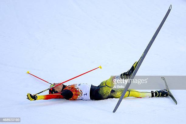 Eric Frenzel of Germany collapses as he wins the gold medal during the Nordic Combined Individual Gundersen Normal Hill and 10km Cross Country on day...