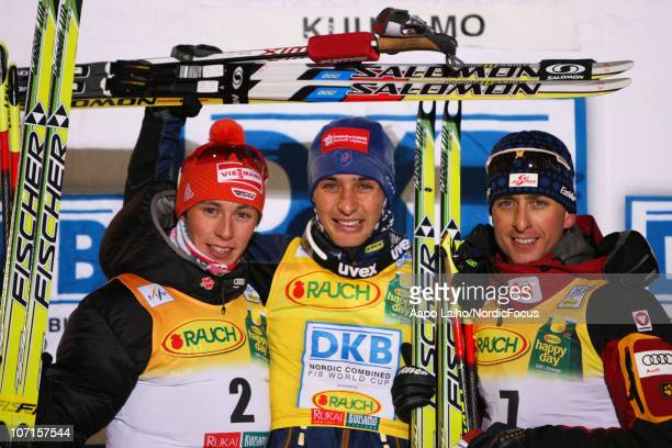 Eric Frenzel of Germany Jason Lamy Chappuis of France and Mario Stecher of Austria pose on the podium after the Gundersen Ski Jumping HS 142/10km...