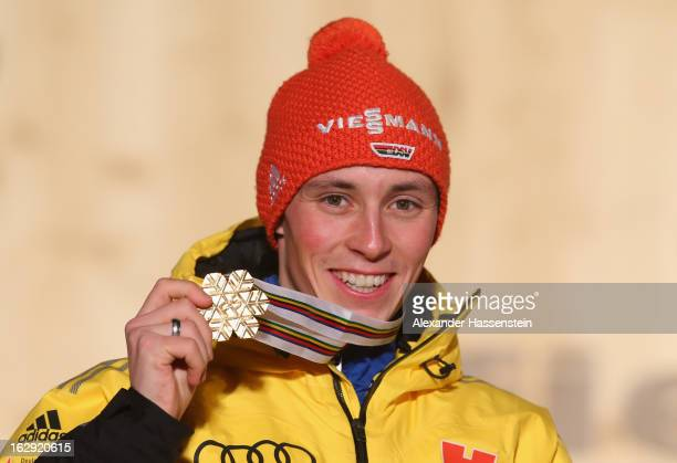 Eric Frenzel of Germany poses with his Gold medal during the Medal Ceremony for the Men's Nordic Combined Individual Gundersen 10Km at the FIS Nordic...