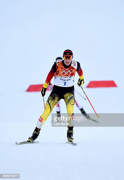 Eric Frenzel of Germany races to the finish line to win the gold medal during the Nordic Combined Individual Gundersen Normal Hill and 10km Cross...