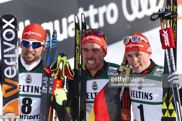 Eric Frenzel of Germany wins the silver medal Johannes Rydzek of Germany wins the gold medal Bjoern Kircheisen of Germany wins the bronze medal...