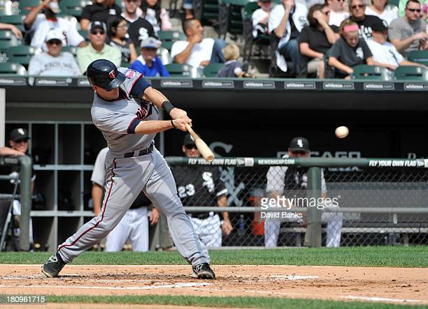 Eric Fryer of the Minnesota Twins hits an RBI single against the Chicago White Sox during the second inning on September 18 2013 at US Cellular Field...