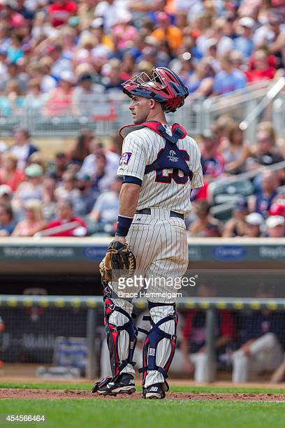Eric Fryer of the Minnesota Twins looks on against the San Diego Padres on August 6 2014 at Target Field in Minneapolis Minnesota The Padres defeated...