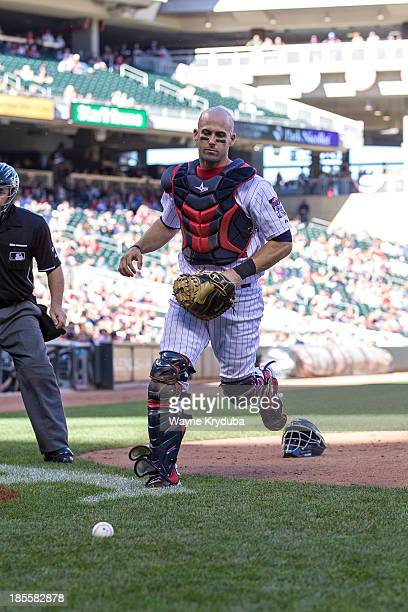 Eric Fryer of the Minnesota Twins runs for a foul ball against the Cleveland Indians on September 29 2013 at Target Field in Minneapolis Minnesota...