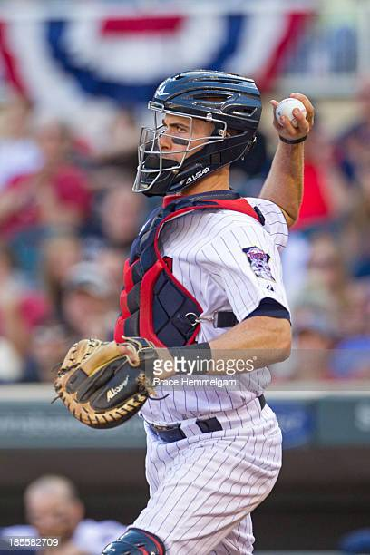 Eric Fryer of the Minnesota Twins throws against the Cleveland Indians on September 29 2013 at Target Field in Minneapolis Minnesota The Indians...
