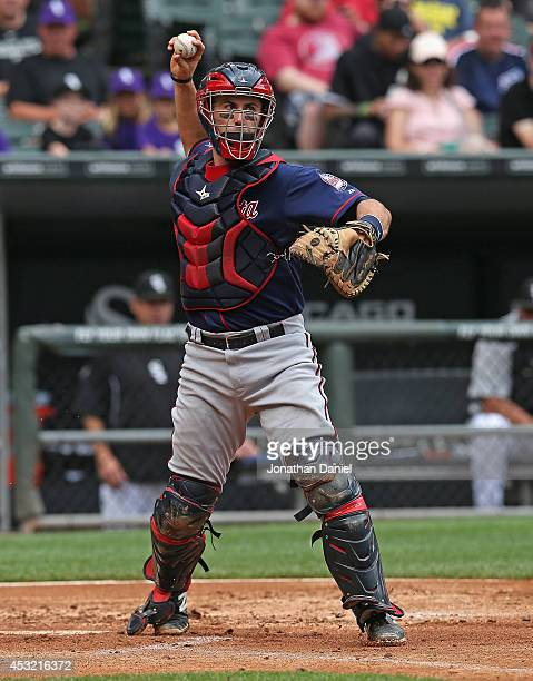 Eric Fryer of the Minnesota Twins throws to first base against the Chicago White Sox at US Cellular Field on August 3 2014 in Chicago Illinois The...