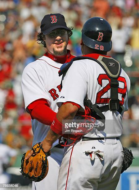 Eric Gagne of the Boston Red Sox celebrates with catcher Doug Mirabelli after defeating the Baltimore Orioles on August 2 2007 at Fenway Park in...