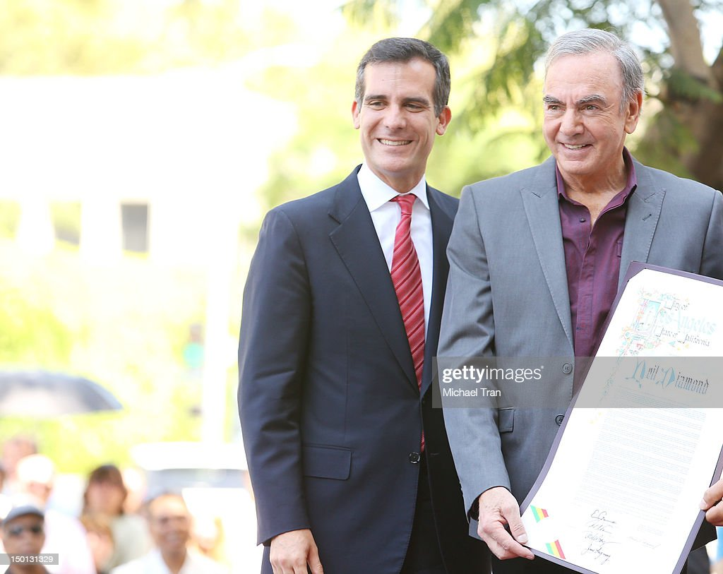 <a gi-track='captionPersonalityLinkClicked' href=/galleries/search?phrase=Eric+Garcetti&family=editorial&specificpeople=635706 ng-click='$event.stopPropagation()'>Eric Garcetti</a> (L) and musician <a gi-track='captionPersonalityLinkClicked' href=/galleries/search?phrase=Neil+Diamond&family=editorial&specificpeople=210635 ng-click='$event.stopPropagation()'>Neil Diamond</a> attend the ceremony honoring musician <a gi-track='captionPersonalityLinkClicked' href=/galleries/search?phrase=Neil+Diamond&family=editorial&specificpeople=210635 ng-click='$event.stopPropagation()'>Neil Diamond</a> with a Star on The Hollywood Walk of Fame held in front of the famed Capitol Records building on August 10, 2012 in Los Angeles, California.