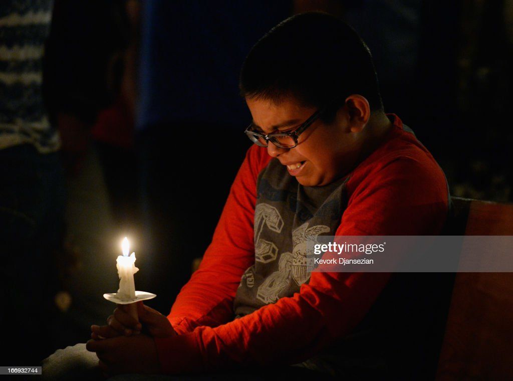 Eric Garcia,12, cries during a candelight vigil and prayer honoring the victims of West Fertilizer Company explosion at St. Mary's Assumption Catholic Church April 18, 2013 in West, Texas. A fiery explosion that damaged or destroyed buildings within a half-mile radius ripped through the facility last night, injuring more than 160 people and killing an unknown number of others.