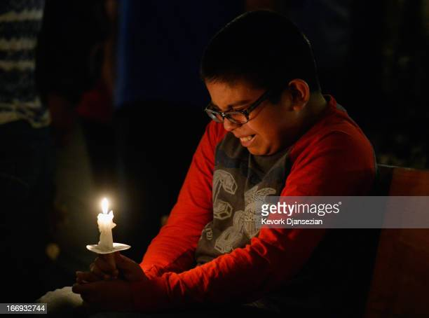 Eric Garcia cries during a candelight vigil and prayer honoring the victims of West Fertilizer Company explosion at St Mary's Assumption Catholic...
