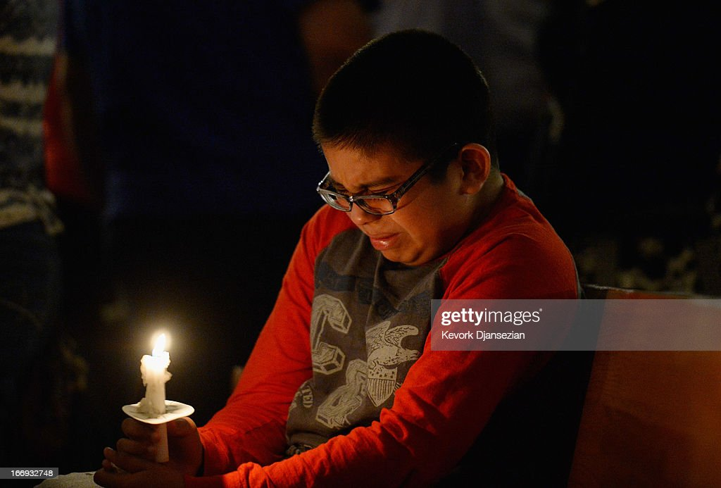 Eric Garcia, 12, cries during a candelight vigil and prayer honoring the victims of West Fertilizer Company explosion at St. Mary's Assumption Catholic Church April 18, 2013 in West, Texas. A fiery explosion that damaged or destroyed buildings within a half-mile radius ripped through the facility last night, injuring more than 160 people and killing an unknown number of others.