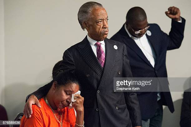 Eric Garner's widow Esaw Garner is comforted by Al Sharpton at the National Action Network headquarters at an event commemorating the two year...