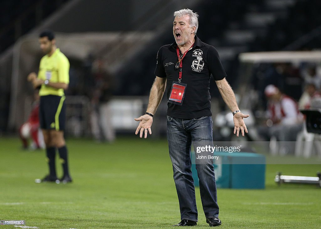 <a gi-track='captionPersonalityLinkClicked' href=/galleries/search?phrase=Eric+Gerets&family=editorial&specificpeople=2104948 ng-click='$event.stopPropagation()'>Eric Gerets</a>, coach of Lekhwiya SC reacts during the friendly match between Paris Saint-Germain FC and Lekhwiya Sports Club at the Al-Sadd Sports Club stadium on January 2, 2013 in Doha, Qatar.