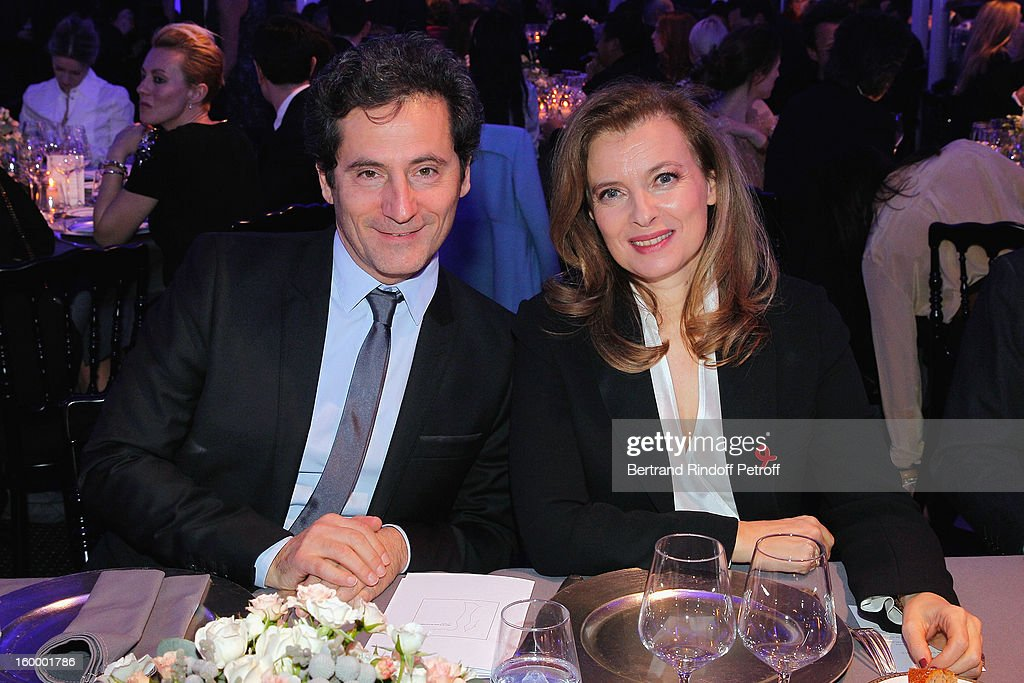 Eric Ghebali (L) and Valerie Trierweiler attend the Sidaction Gala Dinner 2013 at Pavillon d'Armenonville on January 24, 2013 in Paris, France.