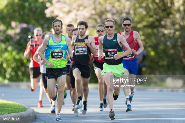 Eric Gillis of Canada starts pulling to the lead of the Canadian runners pack and to an eventual victory in the Canadian 10K road racing championship...