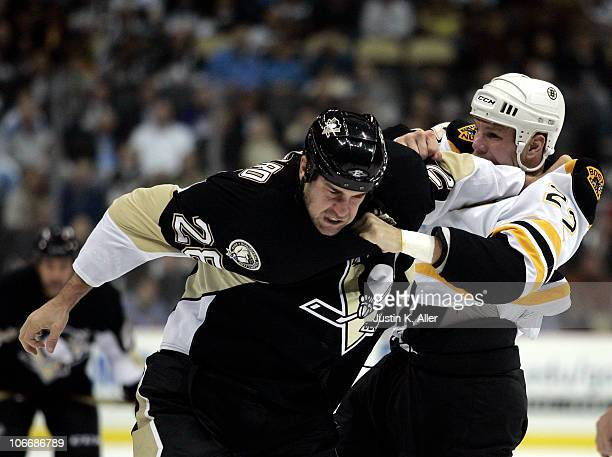 Eric Godard of the Pittsburgh Penguins mixes it up with Shawn Thornton of the Boston Bruins at Consol Energy Center on November 10 2010 in Pittsburgh...