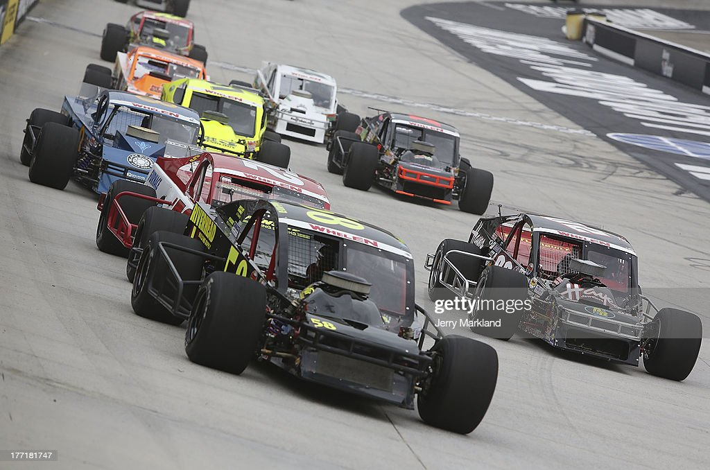 Eric Goodale, driver of the Riverhead Building Suppl Chevrolet leads a group of cars during the NASCAR Whelen Modified Titan Roof 150 at Bristol Motor Speedway on August 21, 2013 in Bristol, Tennessee.