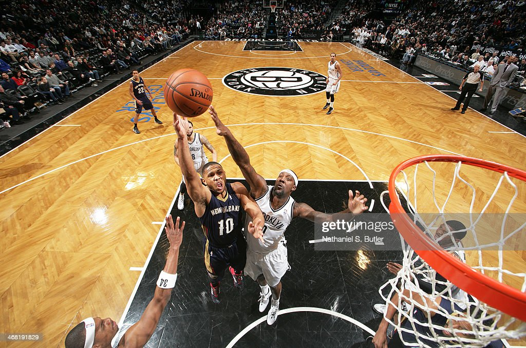 Eric Gordan #10 of the New Orleans Pelicans shoots past <a gi-track='captionPersonalityLinkClicked' href=/galleries/search?phrase=Andray+Blatche&family=editorial&specificpeople=4282797 ng-click='$event.stopPropagation()'>Andray Blatche</a> #0 of the Brooklyn Nets during a game at the Barclays Center on February 9, 2014 in the Brooklyn borough of New York City.