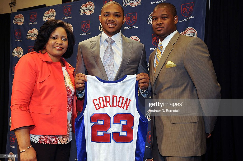 Eric Gordon (C) #23 of the Los Angeles Clippers poses for a photo with his mother Denise Gordon (L) and cousin Richard Bishop (R) during a press conference on July 2, 2008 at Staples Center in Los Angeles, California.