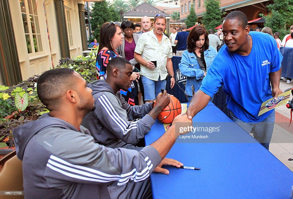 Eric Gordon and Anthony Morrow of the New Orleans Pelicans participate in a Pep Rally with fans on October 28, 2013 at the Manning's Restaurant in New Orleans, Louisiana.