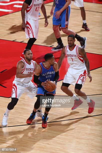 Eric Gordon and Trevor Ariza of the Houston Rockets defend Russell Westbrook of the Oklahoma City Thunder in Game Five of the Western Conference...