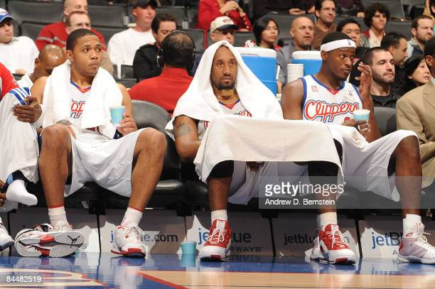 Eric Gordon Brian Skinner and Al Thornton of the Los Angeles Clippers look on from the bench during a game against the Portland Trail Blazers at...