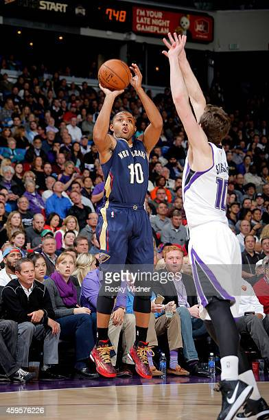 Eric Gordon fo the New Orleans Pelicans shoots a three pointer against Nik Stauskas of the Sacramento Kings on November 18 2014 at Sleep Train Arena...