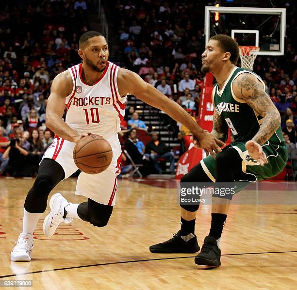 Eric Gordon of the Houston Rockets drives past Michael Beasley of the Milwaukee Bucks at Toyota Center on January 18 2017 in Houston Texas NOTE TO...