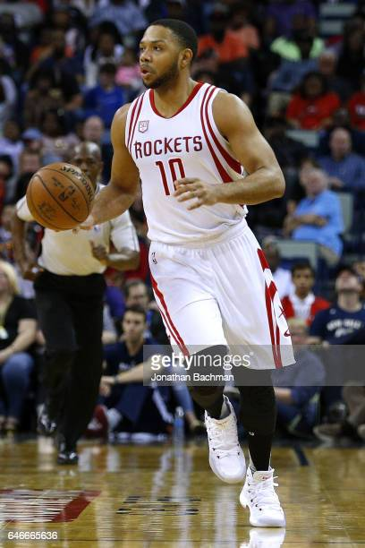 Eric Gordon of the Houston Rockets drives with the ball during a game against the New Orleans Pelicans at the Smoothie King Center on February 23...