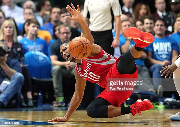 Eric Gordon of the Houston Rockets gets tripped up against the Dallas Mavericks in the second half at American Airlines Center on October 28 2016 in...