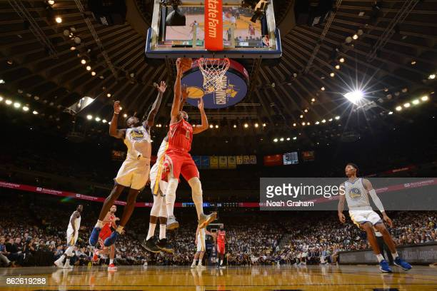 Eric Gordon of the Houston Rockets goes to the basket against the Golden State Warriors on October 17 2017 at ORACLE Arena in Oakland California NOTE...