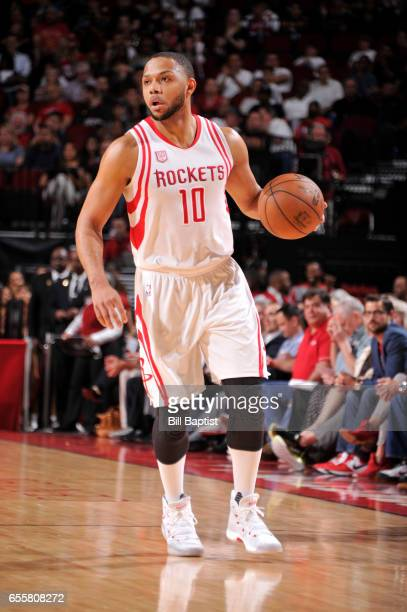 Eric Gordon of the Houston Rockets handles the ball during a game against the Denver Nuggets on March 20 2017 at the Toyota Center in Houston Texas...
