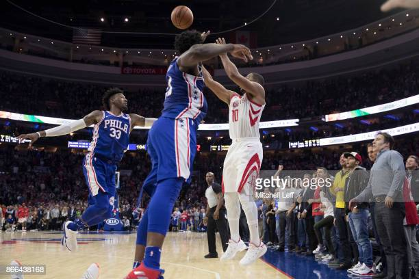 Eric Gordon of the Houston Rockets hits a gamewinning three pointer against Robert Covington and Joel Embiid of the Philadelphia 76ers as time...