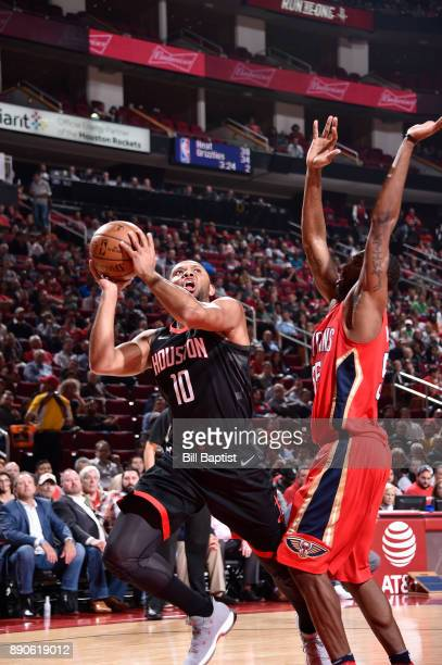 Eric Gordon of the Houston Rockets passes the ball against the New Orleans Pelicans on December 11 2017 at the Toyota Center in Houston Texas NOTE TO...