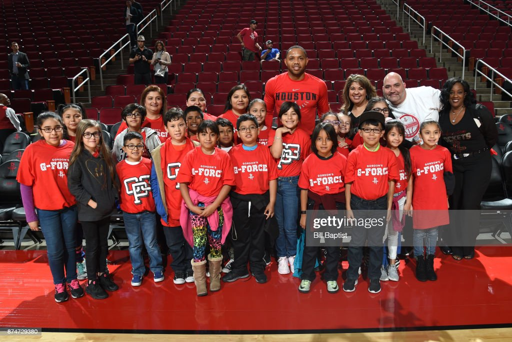 Eric Gordon #10 of the Houston Rockets poses with fans prior to the game against the Toronto Raptors on November 14, 2017 at the Toyota Center in Houston, Texas.